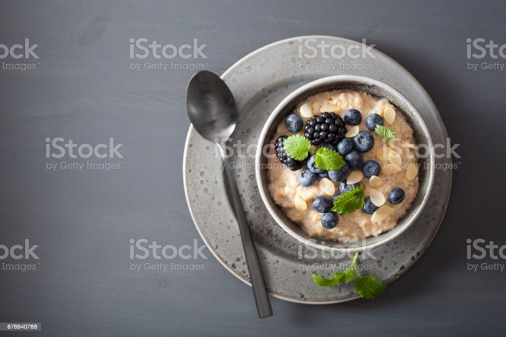 healthy breakfast steel cut oatmeal porridge with blueberry blackberry stock photo