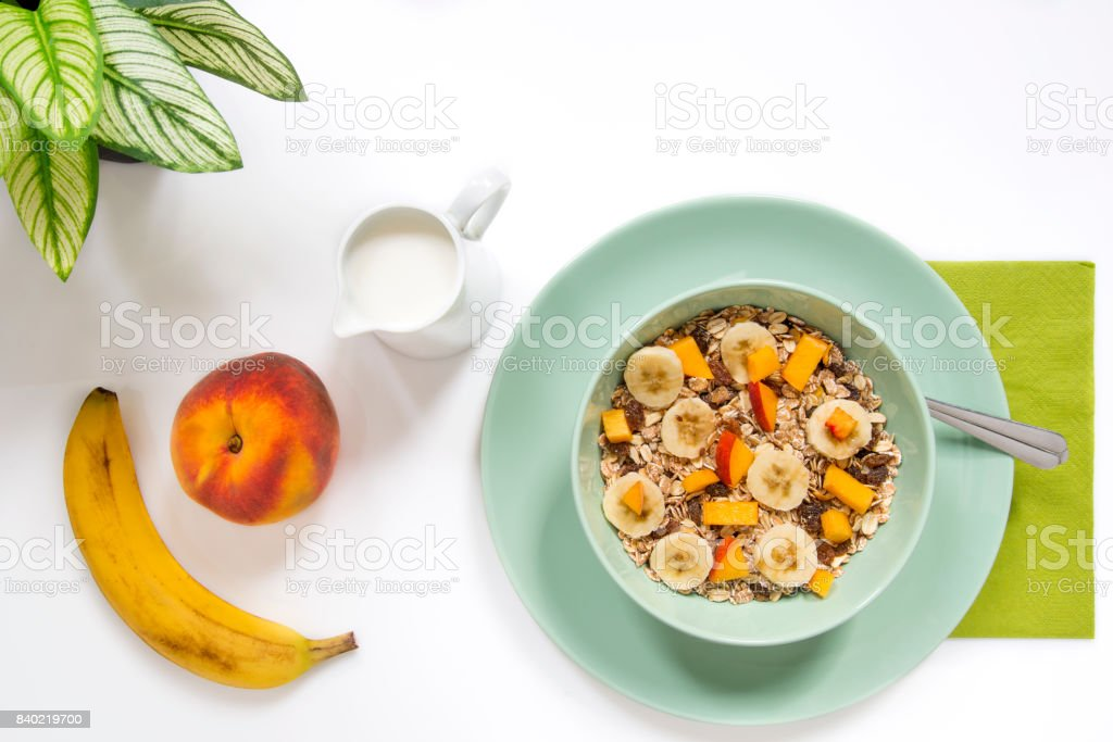 Healthy breakfast with cereal mixed fruits and green colors early morning. stock photo