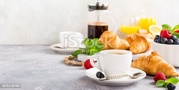 istock Healthy breakfast with coffee and croissants 675416700