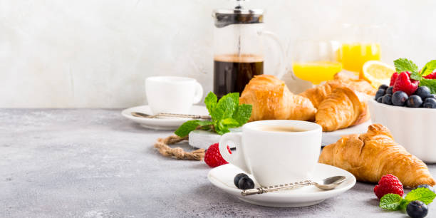Healthy breakfast with coffee and croissants stock photo