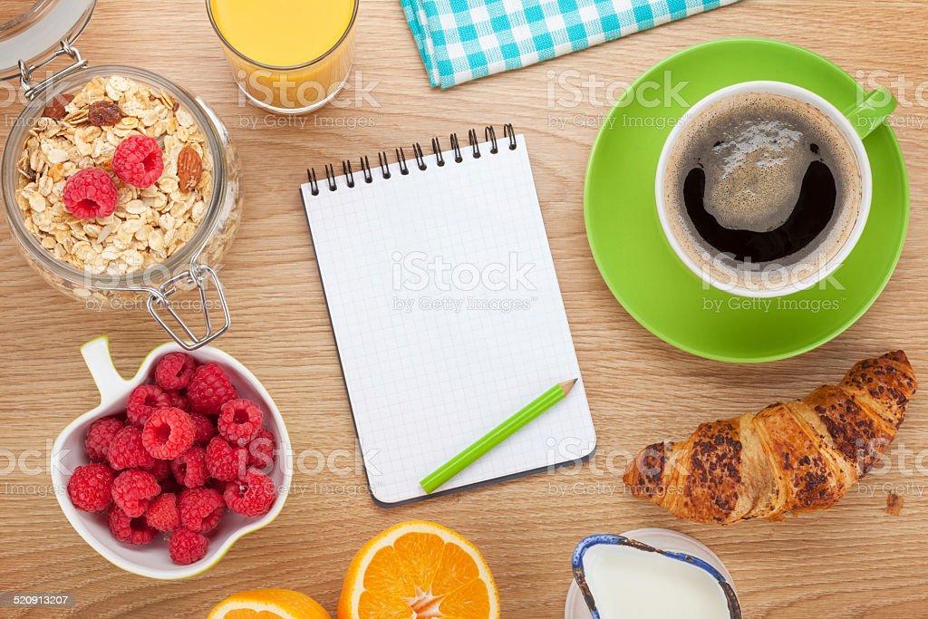 Healthy breakfast with muesli, berries, orange juice and croissa stock photo