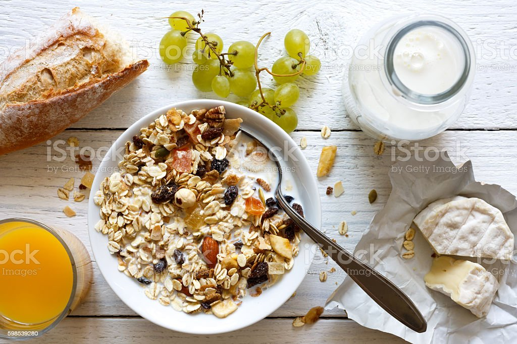 Healthy breakfast with muesli, grapes, cheese and juice on rusti stock photo