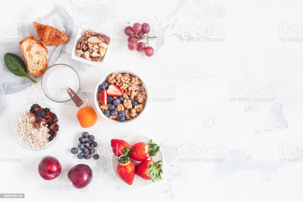 Healthy breakfast with muesli, yogurt, fruits, berries, nuts stock photo