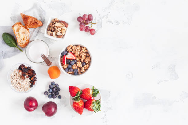 healthy breakfast with muesli, yogurt, fruits, berries, nuts - breakfast stock photos and pictures