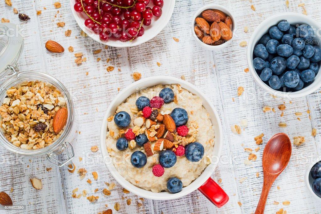 Healthy breakfast with oatmeal porridge, muesli and fruits stock photo