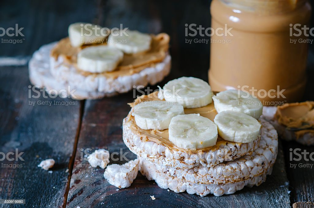 Healthy breakfast with rice cakes, peanut butter and bananas stock photo