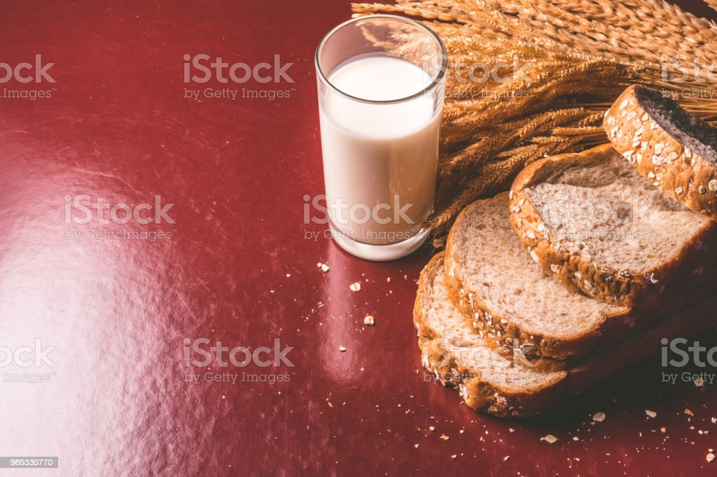 Healthy breakfast with whole wheat bread and milk on the table. copy space zbiór zdjęć royalty-free
