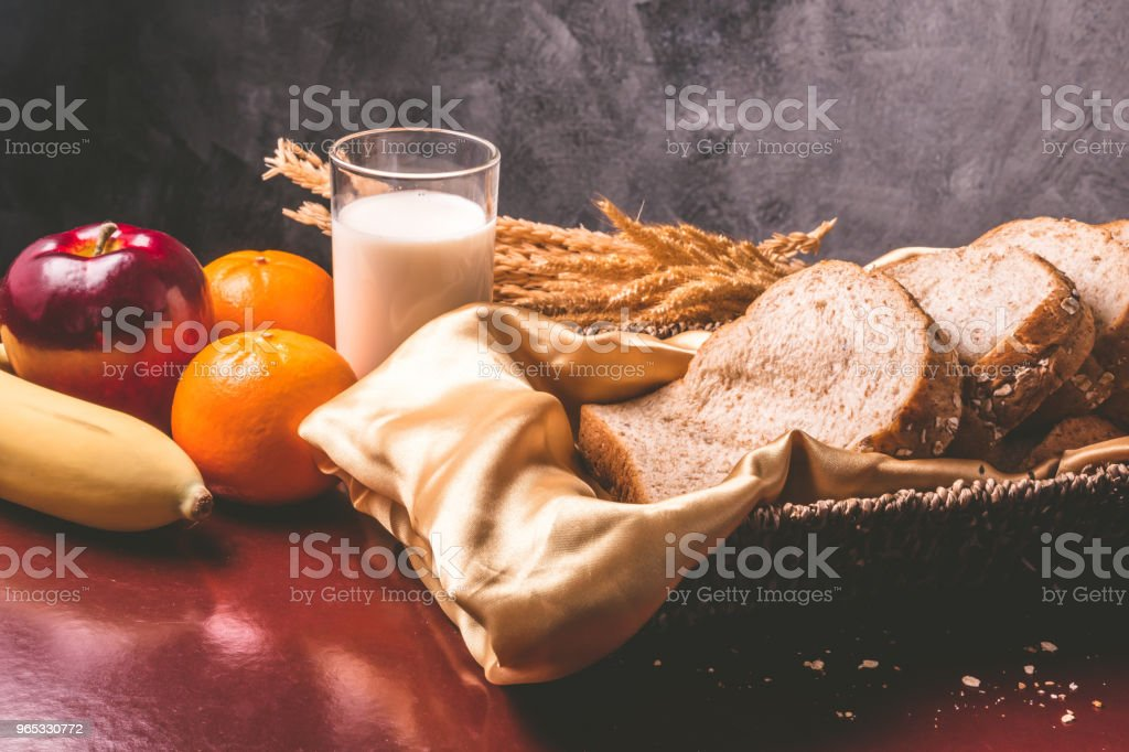 Healthy breakfast with whole wheat bread, milk and fruits on the table zbiór zdjęć royalty-free