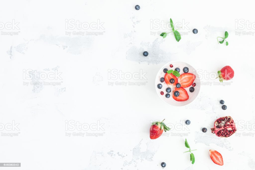 Healthy breakfast with yogurt and fruits. Top view, flat lay stock photo