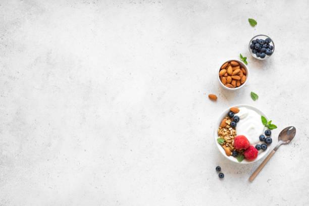 Healthy breakfast with yogurt, granola, berries stock photo