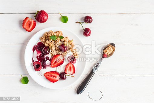 599887760 istock photo healthy breakfast with yogurt, muesli and berries, flat lay 597210590