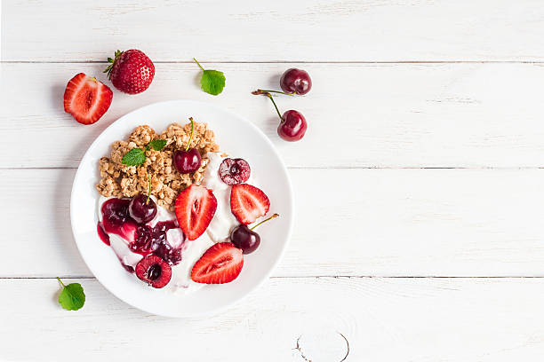 healthy breakfast with yogurt, muesli and berries - breakfast stock photos and pictures
