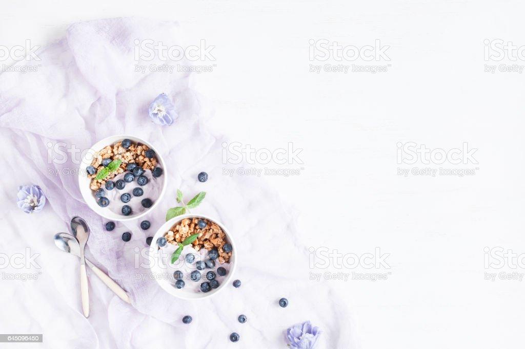 Healthy breakfast with yogurt, muesli and berries stock photo