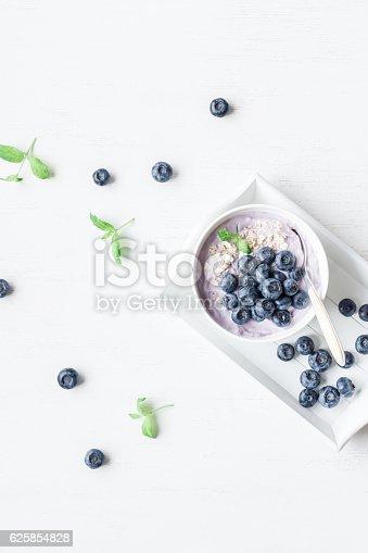 599887760 istock photo Healthy breakfast with yogurt, muesli and blueberry 625854828