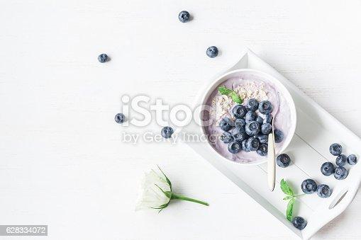 599887760 istock photo Healthy breakfast with yogurt, muesli and blueberry 628334072