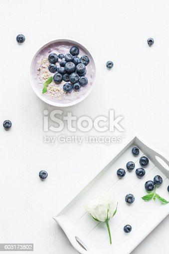 599887760 istock photo Healthy breakfast with yogurt, muesli and blueberry. Top view, f 603173802