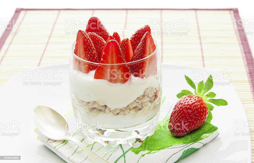 Healthy breakfast - yoghurt with granola and strawberries stock photo