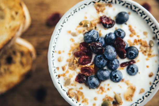 Healthy Breakfast, Yogurt, Granola And Toasts stock photo