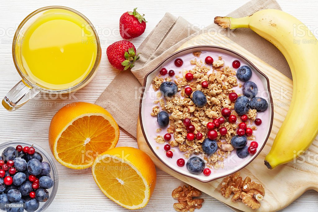 Healthy breakfast. Yogurt with granola and berries stock photo