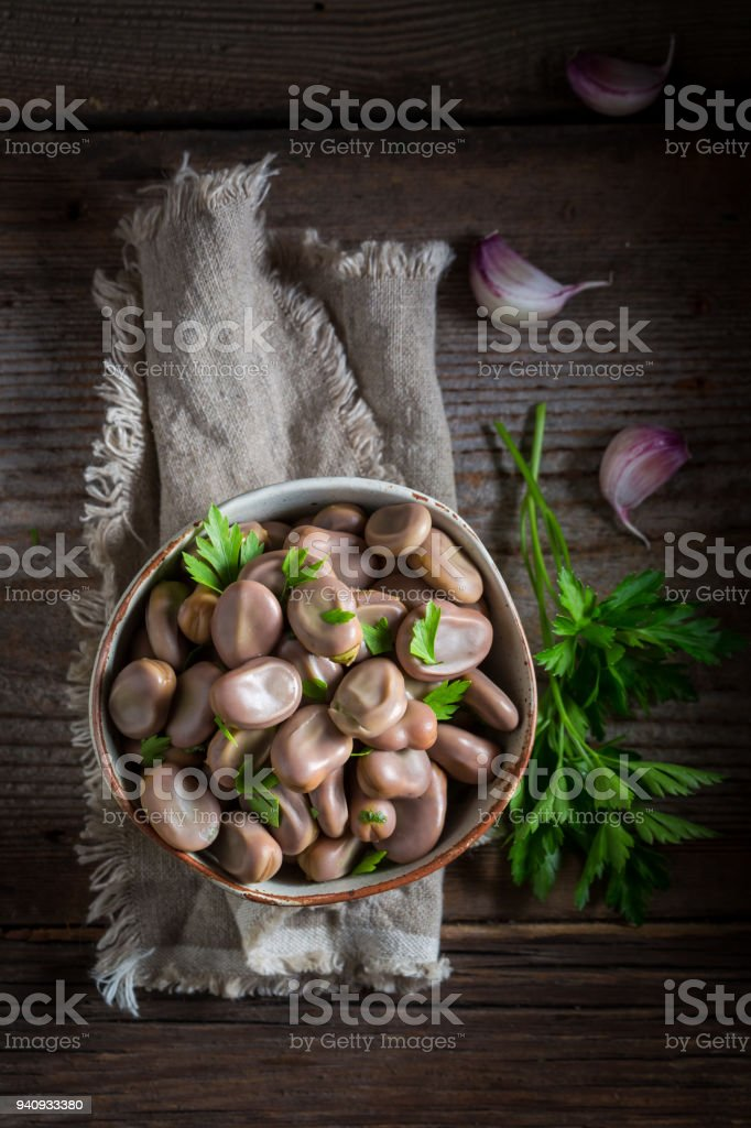 Healthy broad beans boiled with parsley and garlic stock photo