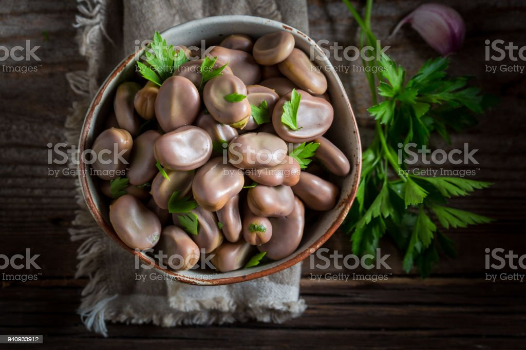 Healthy broad beans in old rustic kitchen stock photo