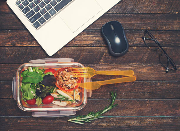 healthy business lunch at workplace. vegetables and fried chicken lunch box on working desk with laptop and glasses. - preparation stock pictures, royalty-free photos & images