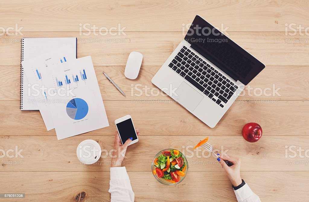 Healthy business lunch of woman at working place. stock photo