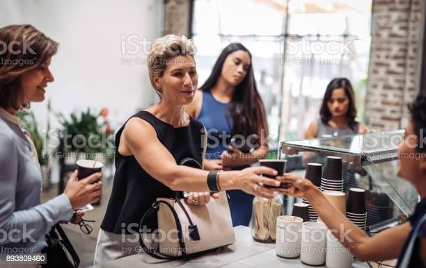 Healthy businesswoman ordering organic coffee in vegan snack bar picture id893809460?b=1&k=6&m=893809460&s=612x612&h=b5l63aqqy8sdolganvbehqcdvkehqfhghelmj1uspcu=