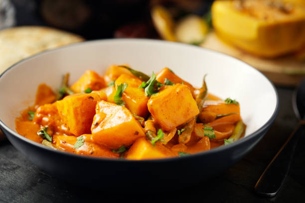 Healthy butternut squash and beans curry Home made freshness butternut squash and green beans tikka with wild rice and naan bread sweet potato stock pictures, royalty-free photos & images