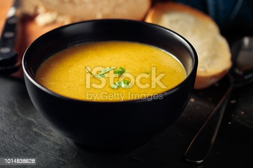 Home made freshness Healthy butternut squash, red lentils and coriander red chilli  soup with home made white bread