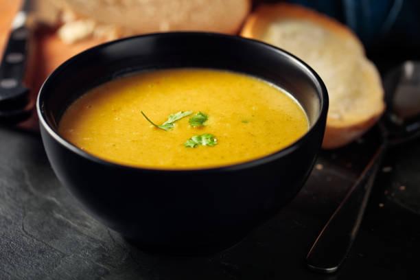 healthy butternut squash,red lentils and coriander soup - sopa imagens e fotografias de stock