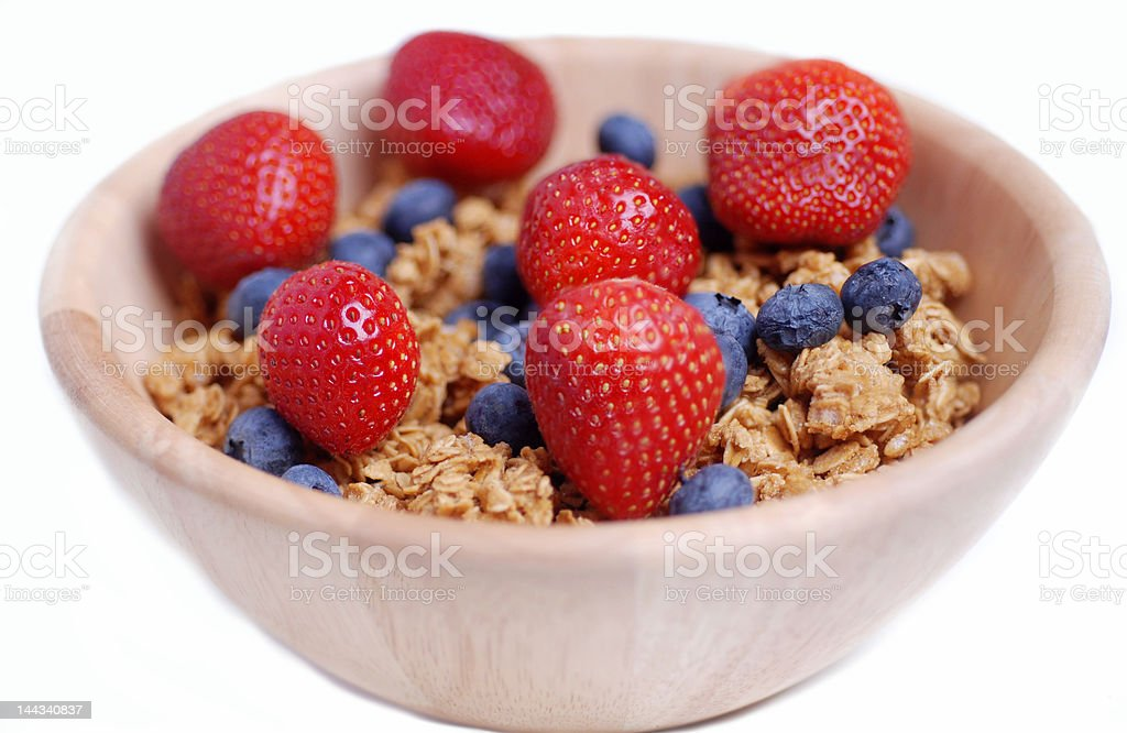 Healthy cereal oats strawberries and blueberries royalty-free stock photo