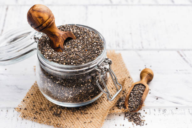 healthy chia seeds in a glass jar - chia seed stock photos and pictures