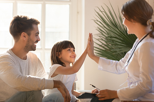 istock Healthy child girl giving high five to doctor celebrate recovery 1130696738