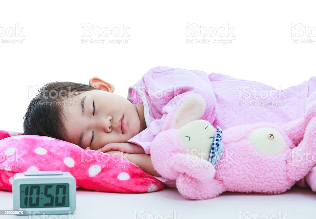 Healthy children concept. Asian girl sleeping peacefully. On whi royalty-free stock photo