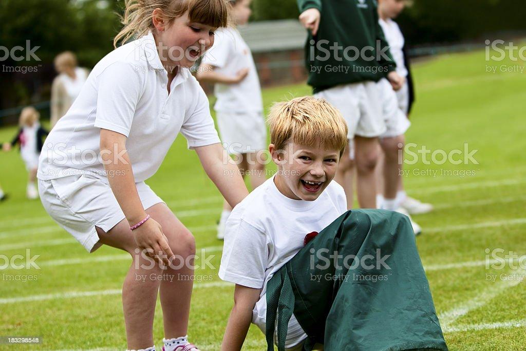 healthy children having fun exercising at school stock photo