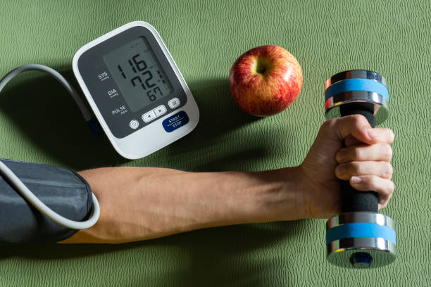 Healthy concept. Exercise and healthy eating are the causes of normal blood pressure. Healthy concept. Exercise and healthy eating are the causes of normal blood pressure. hypertensive stock pictures, royalty-free photos & images