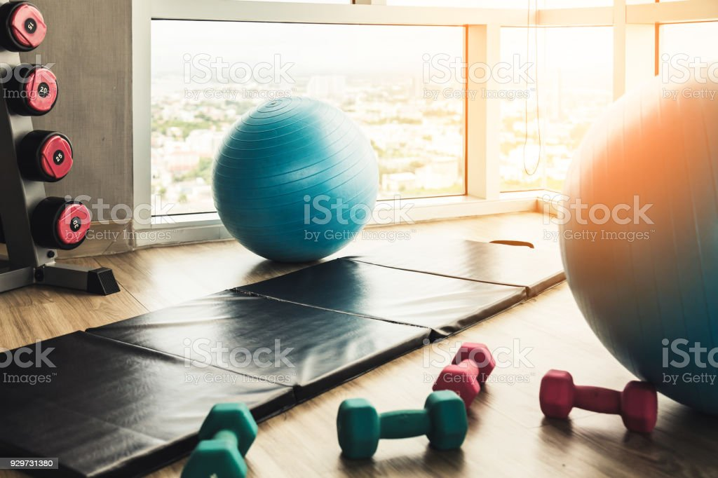 Healthy Concept With Fitness Center Dumbell Rack And Yoga Ball With Exercise Mat On Wooden Floor With Background Of Blue Sky Stock Photo Download Image Now Istock
