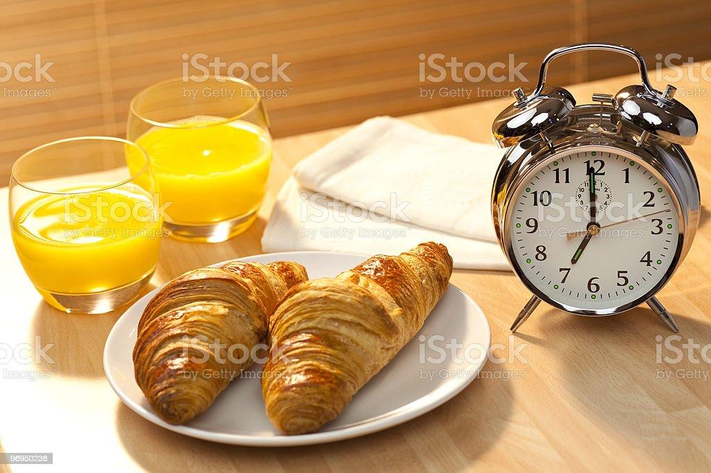 Healthy Continental Breakfast Croissant, Orange Juice & Alarm Clock royalty-free stock photo