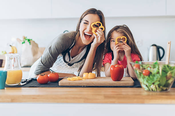 healthy cooking can be so much fun! - kids cooking stock photos and pictures