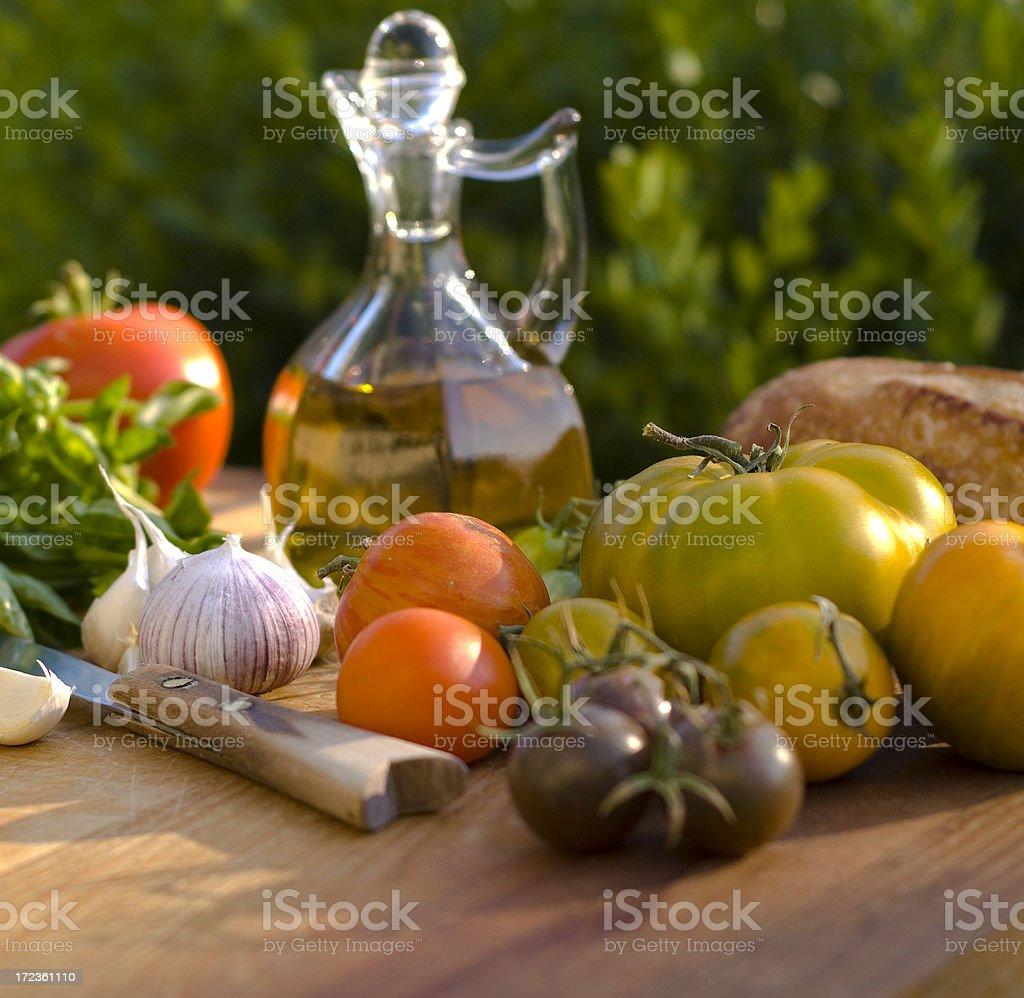 Healthy Cooking Ingredients; Heirloom Tomatoes, Garlic, Herbs & Olive Oil royalty-free stock photo