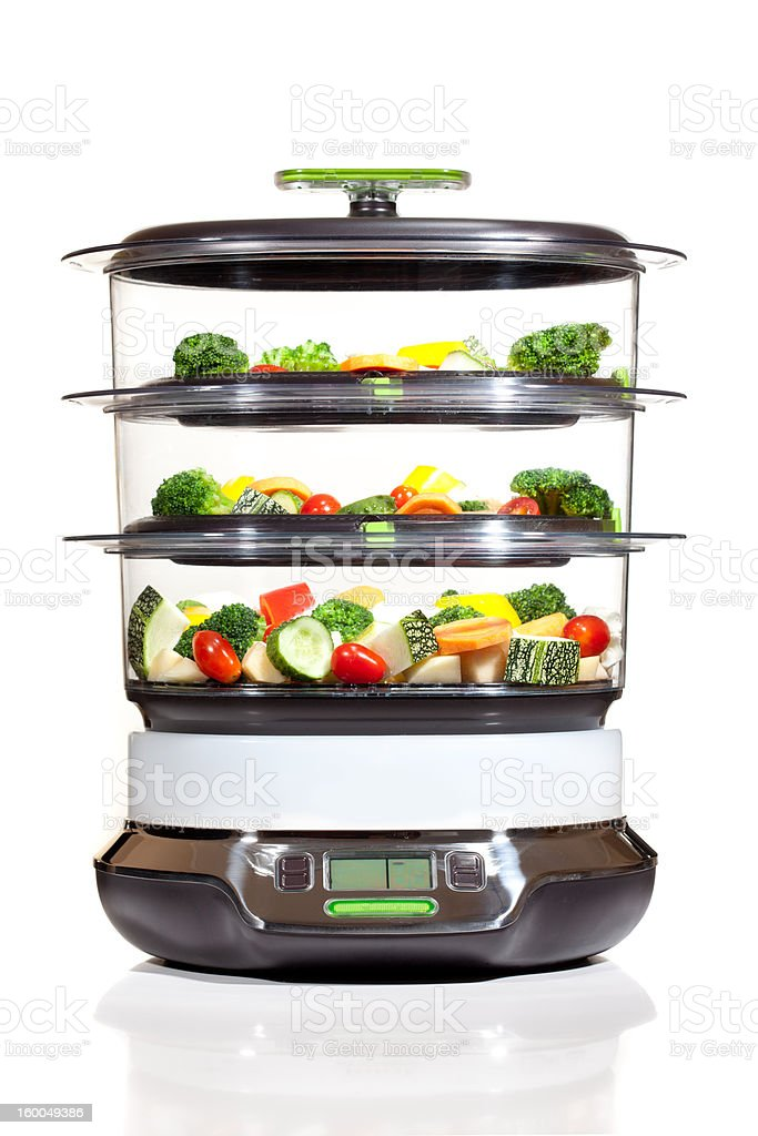 Healthy cooking, steam cooker with vegetables royalty-free stock photo