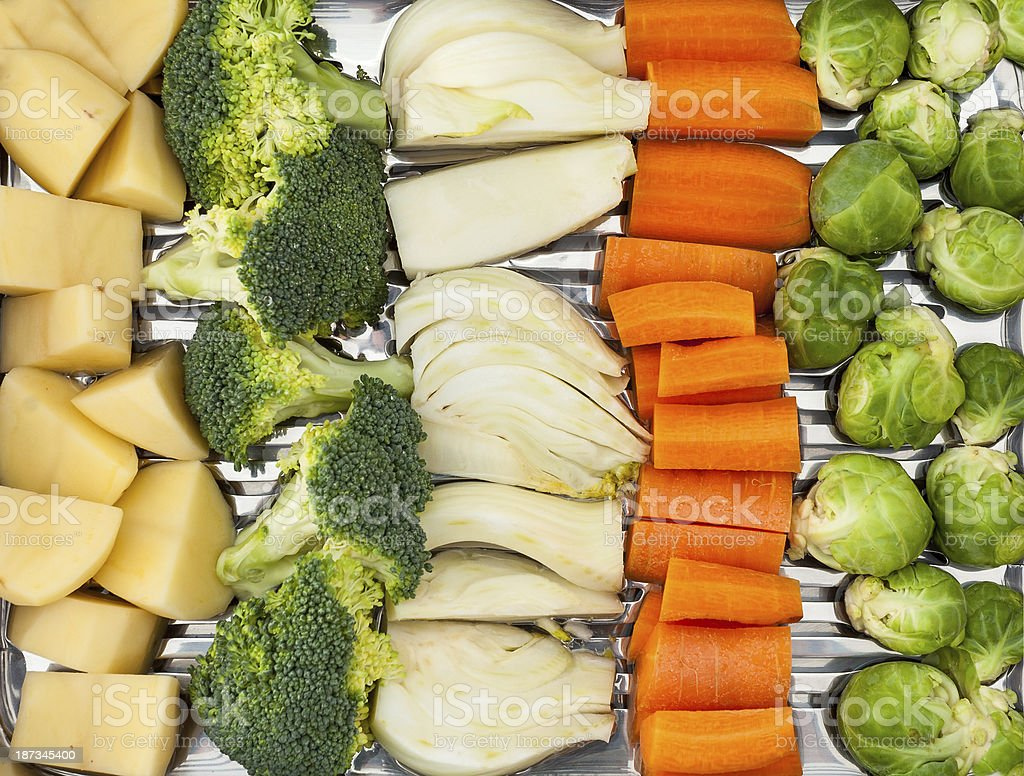 vegetables arranged ready for cooking. Potatoes, broccoli, fennel,...