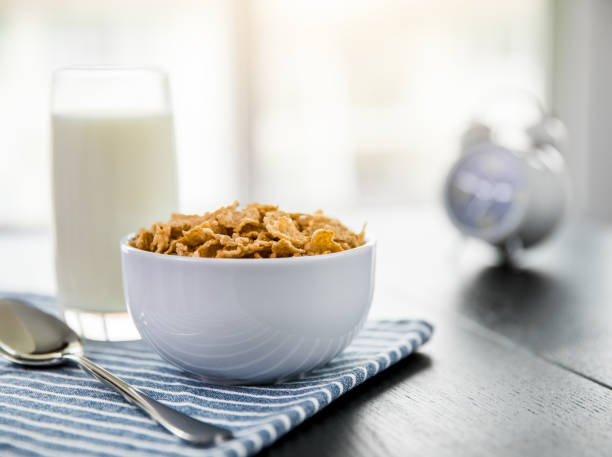 Healthy Corn Flakes with milk for Breakfast on table, food and drink Healthy Corn Flakes with milk for Breakfast on table, food and drink cereal stock pictures, royalty-free photos & images