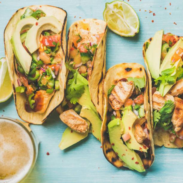 healthy corn tortillas and beer over blue background, square crop - bier gesund stock-fotos und bilder