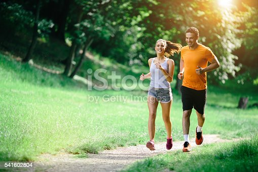 istock Healthy couple jogging in nature 541602804