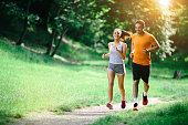 Healthy couple jogging in nature