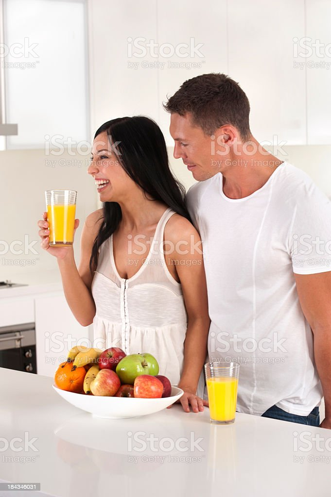 Healthy couple with fruit and juice royalty-free stock photo
