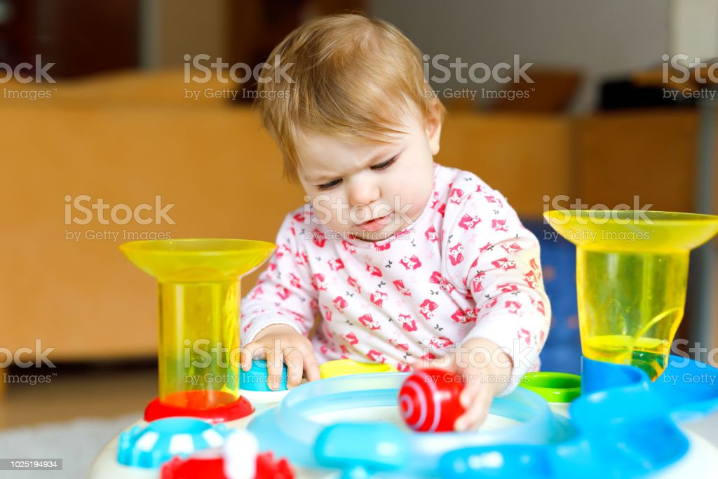 Healthy Cute Beautiful Little Baby Girl Playing With Educational