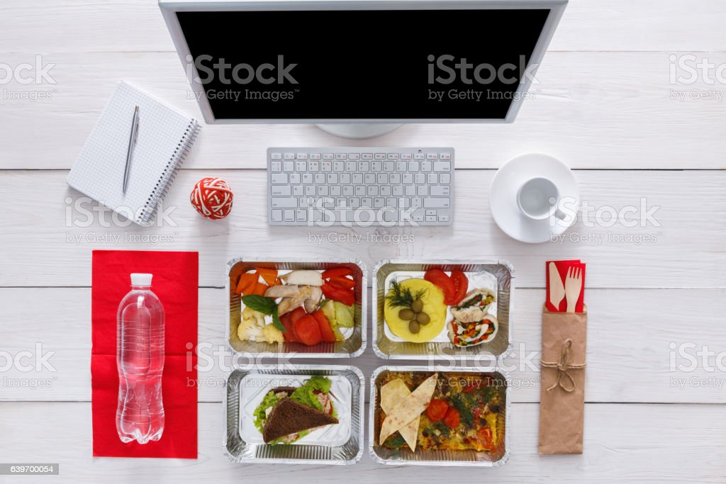 Healthy daily meals in office, top view at wood stock photo